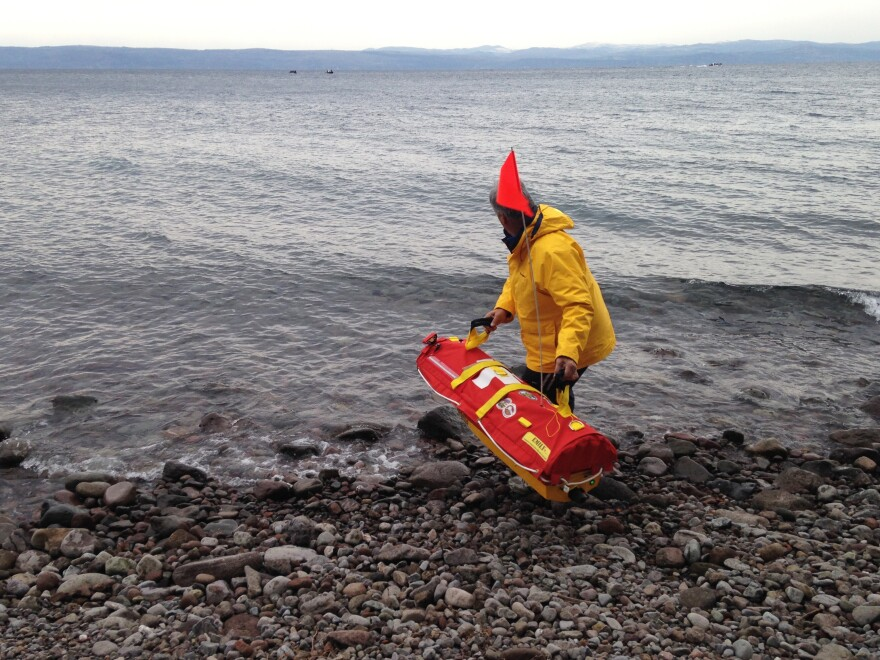 Fernando Boiteux tosses Emily, a remote-controlled lifesaving device, into the waters off the shore of the Greek island of Lesbos. Boiteux, an assistant fire chief from Los Angeles, is helping train Greek first responders to use Emily.
