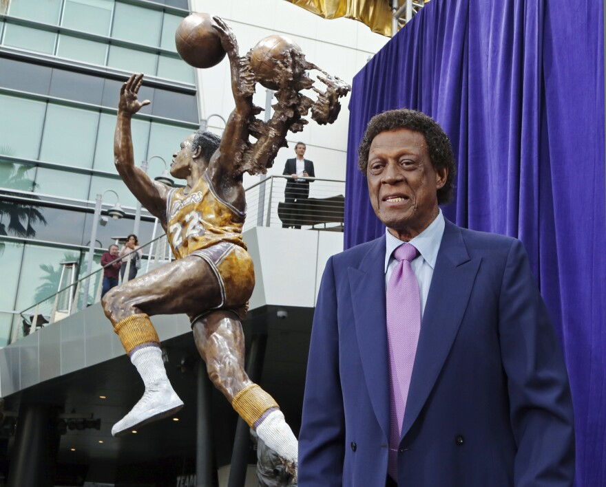 Elgin Baylor stands next to a statue honoring the Minneapolis and Los Angeles Lakers players, outside Staples Center in Los Angeles on April 6.