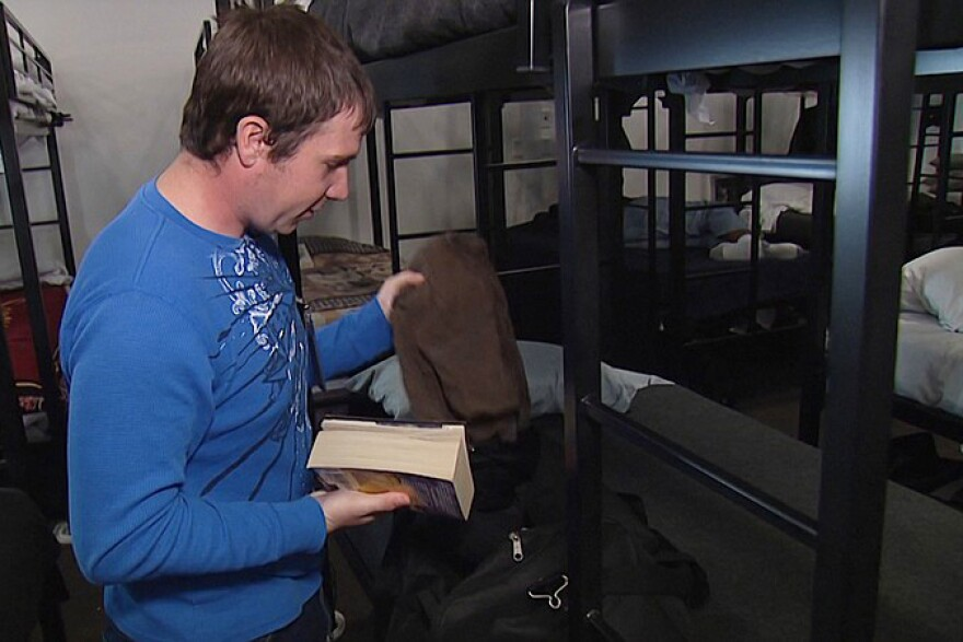 Army veteran Phillip Faustman sifts through his belongings at a San Diego homeless shelter.  Faustman says he attempted suicide three times in two and a half years.