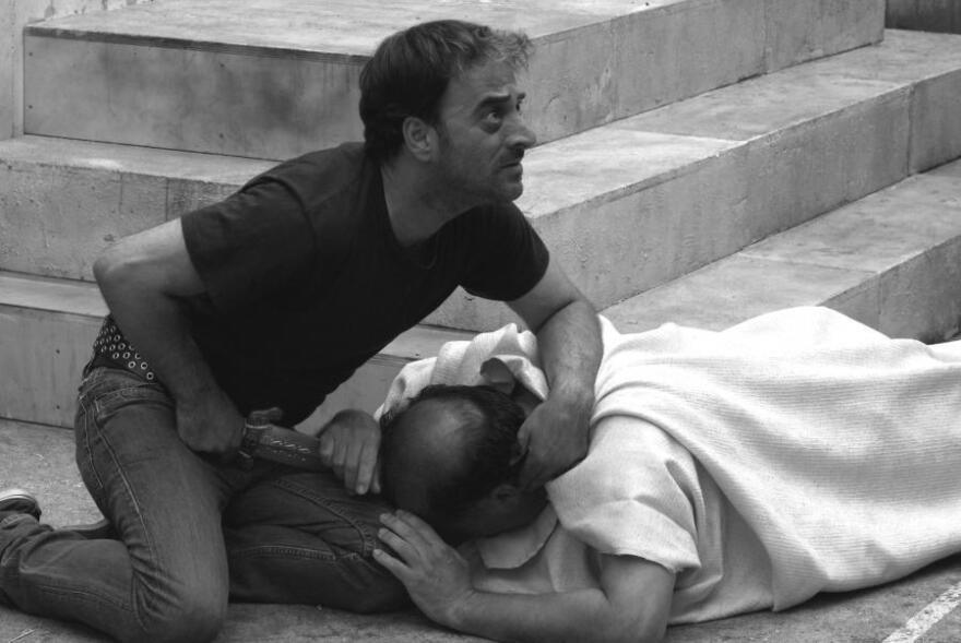 Brutus (Salvatore Striano) delivers the final blow to the dying Caesar (Giovanni Arcuri) during a performance of Shakespeare's <em>Julius</em> <em>Caesar </em>in the film <em>Caesar Must Die.</em>