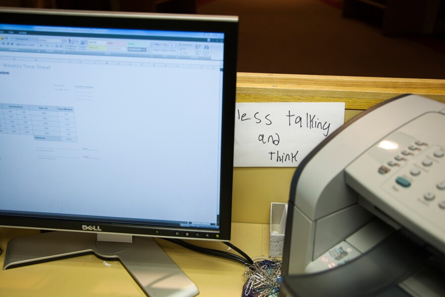 Keleher leaves a reminder note on his desk at the Institute for Community Inclusion, where he works.