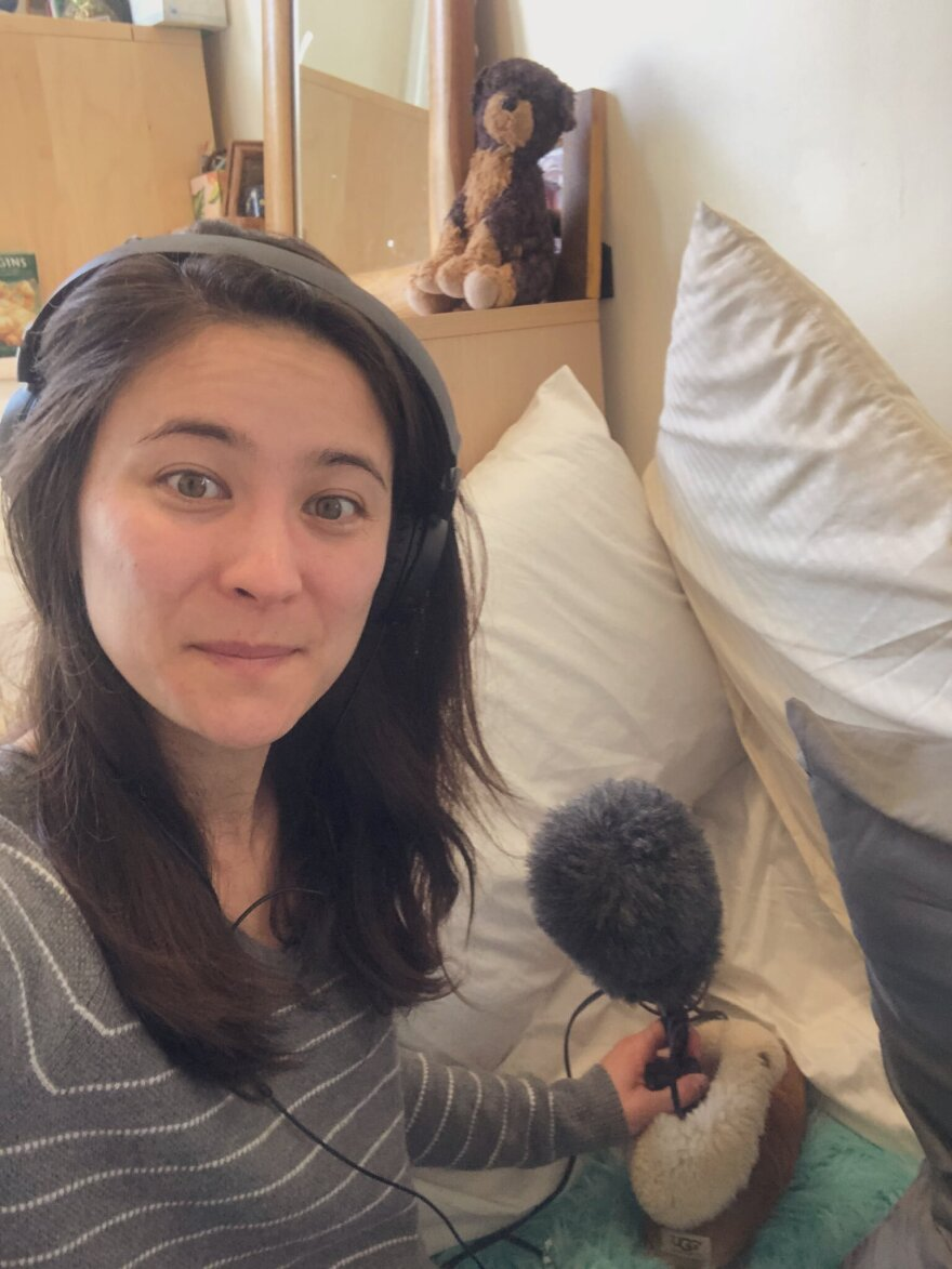 Host/producer Lauren Migaki recorded a podcast from her home/pillow fort studio.