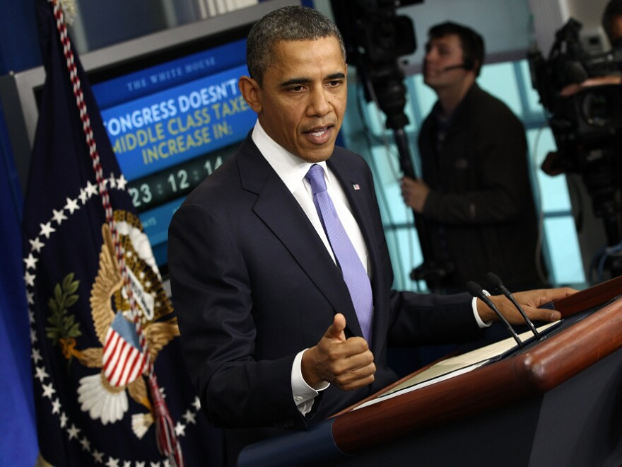 President Obama addresses the media Thursday, with an electronic clock counting down to the end of the year. The payroll tax cut is due to expire then, unless Congress votes to extend it.