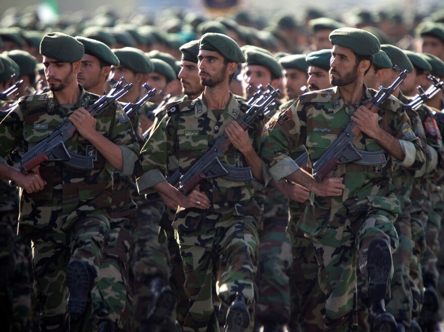 The U.S. has designated Iran's Revolutionary Guard Corps as a terrorist group. Here, members of the force march during a 2007 military parade in Tehran.