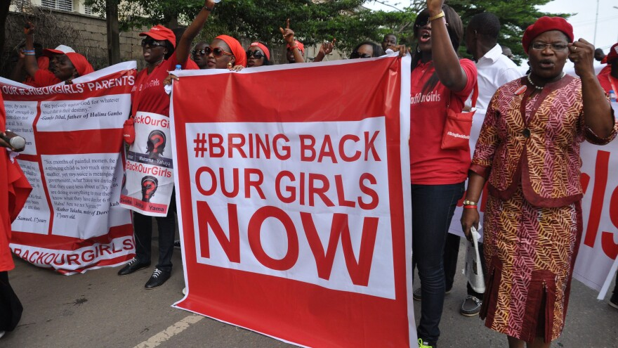 "People call for the Nigerian government to rescue girls taken from a secondary school in Chibok region, during a protest earlier this month. Boko Haram, the group that took the girls, says they have been ""married off."""