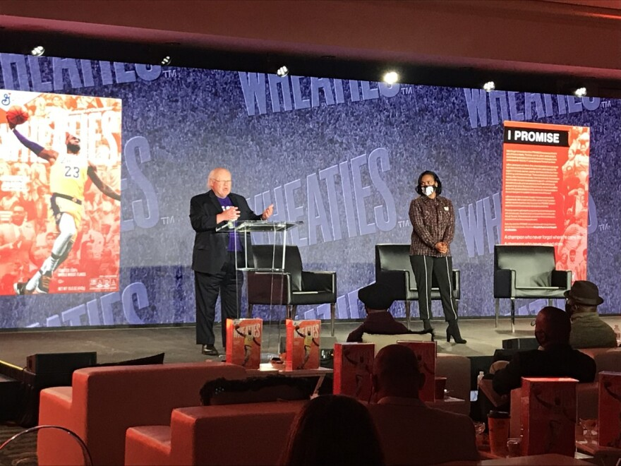 Gloria James on stage with Dave Lieberth and Wheaties box
