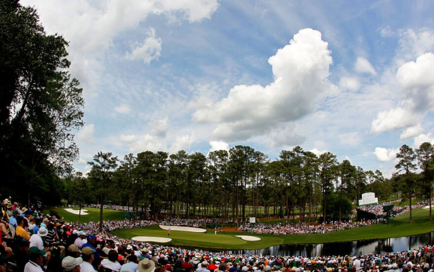 Patrons watch as Henrik Stenson of Sweden, Alvaro Quiros of Spain and Gary Woodland of the United States play the 16th green during the first round of the 2012 Masters Tournament at Augusta National Golf Club on Thursday.