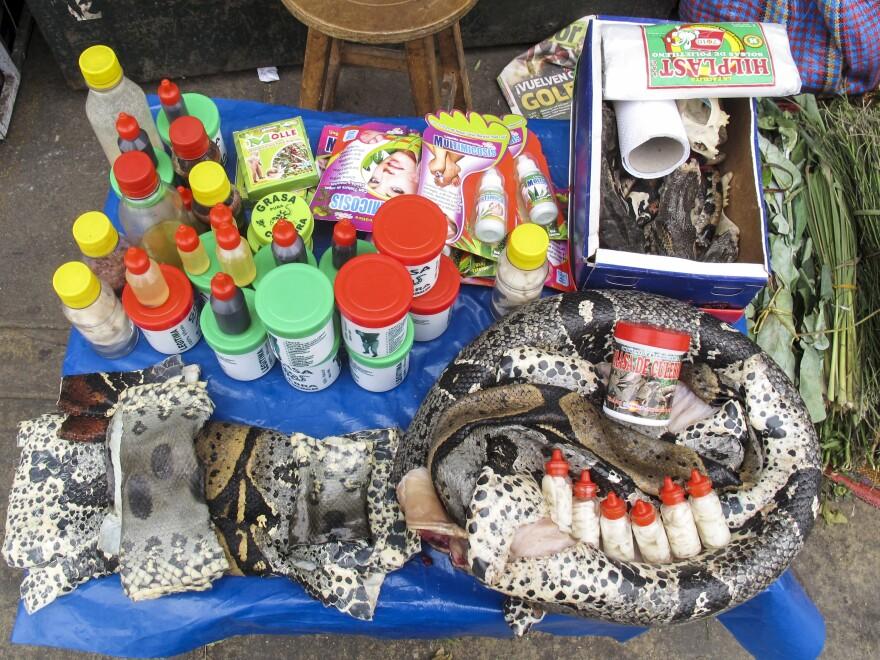 A vendor hawks <em>grasa de culebra</em>, or snake fat, said to have healing properties – for broken bones, fractures and ovarian and back pain.