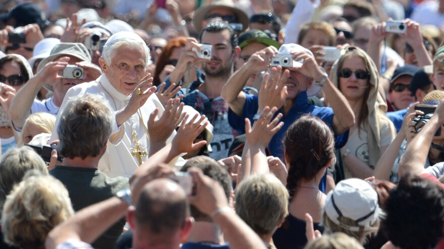 Pope Benedict XVI waves as he arrives for his weekly general audience on May 30 at St. Peter's Square at the Vatican.