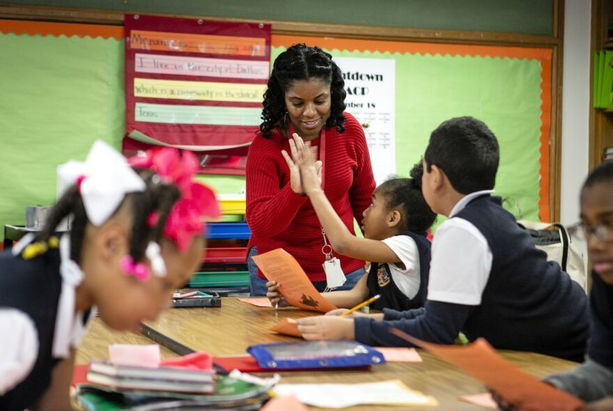 Natasha Boone high fives a student as they went over a story the class was reading Jan. 14, 2019 at Edward Titche Elementary School in the Pleasant Grove area of Dallas.