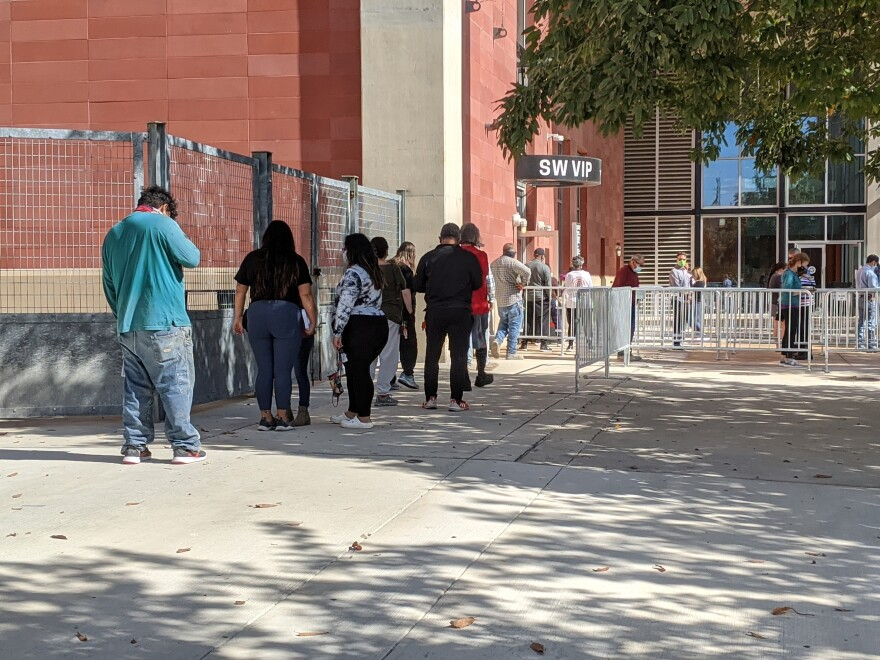 People wait in line outside the AT&T Center for a free asymptomatic coronavirus tests on Nov. 18. Community Labs operates three public testing centers in San Antonio.