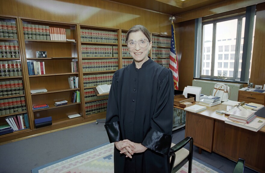 Judge Ruth Bader Ginsburg poses in her robe in her office at U.S. District Court in Washington on Aug. 3, 1993. Earlier, the Senate voted 96-3 to confirm Bader as the 107th justice and the second woman to serve on the Supreme Court. (Doug Mills/AP)