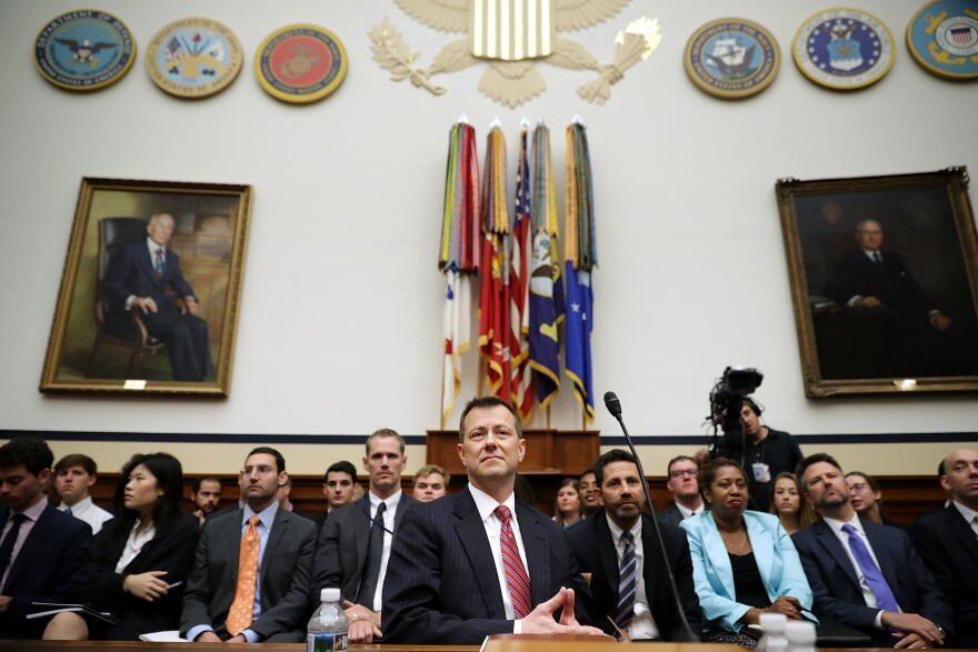 Deputy Assistant FBI Director Peter Strzok (center) waits to testify before a joint committee hearing of the House Judiciary and Oversight and Government Reform committees on Capitol Hill Thursday.