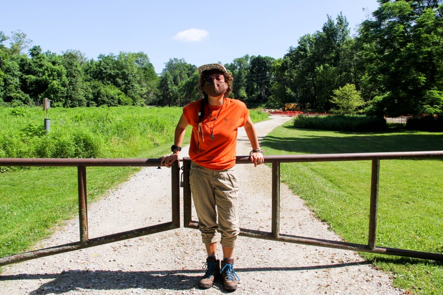 Ecologist Leticia Classen-Rodriguez, who studies wolf spiders at St. Louis University, stands at the closed gates of the Litzsinger Road Ecology Center in Ladue on June 6, 2020.