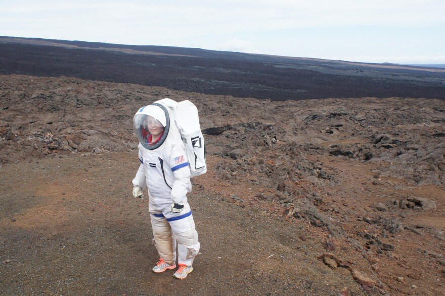 Last year, a crew member of the Hawaii Space Exploration Analog and Simulation mission leaves the dome where they were isolated.