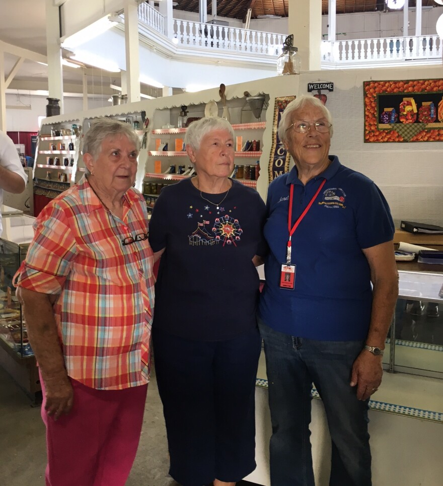 Thelma Denlinger (left) poses with other fair volunteers.