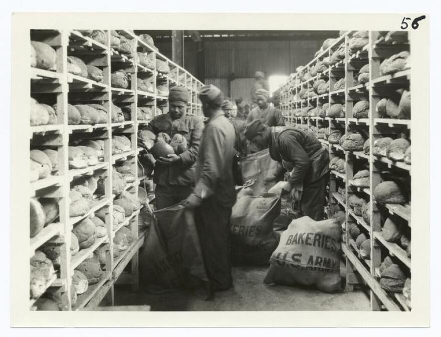 U.S. soldiers sack bread ready for shipment, shortly after the end of World War I.