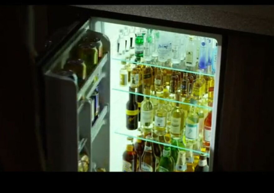 A screenshot from the trailer of <em>Flight</em>, showing the fully stocked (some would say too fully stocked) minibar.