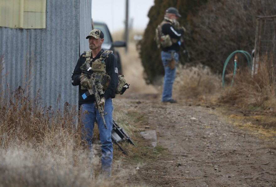 Members of the Real 3%ers Idaho stand watch during a convoy protection drill in western Idaho in January.