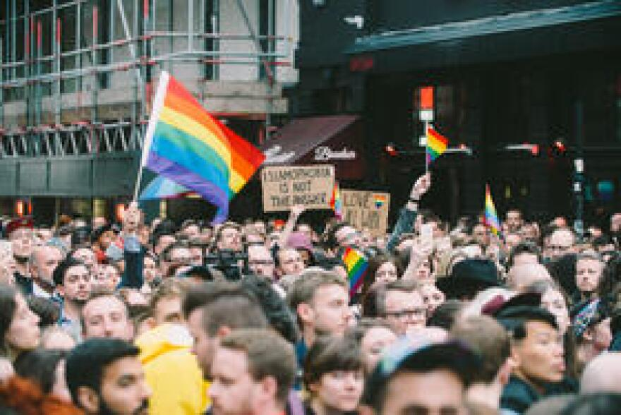 Mourners hold a vigil in the streets of London following the shooting at a gay nightclub. In the wake of the massacre, state lawmakers want to restrict gun access for suspected terrorists.