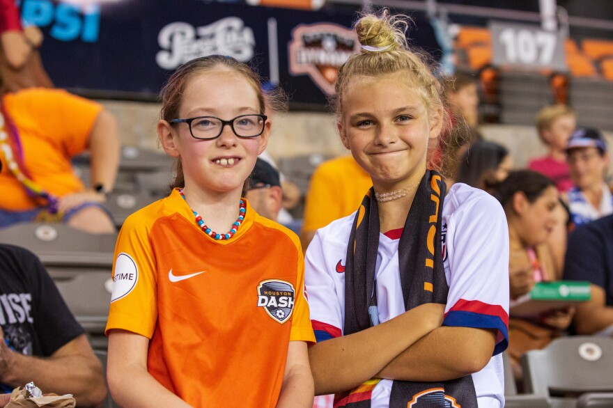 Ava Martin (left), 9, and her friend Remy Haguewood (right), 9, pose for a portrait during the match.