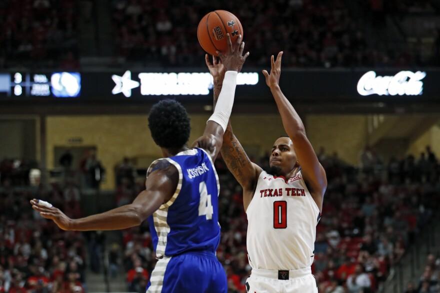 Texas Tech's Kyler Edwards and Eastern Illinois' Marvin Johnson