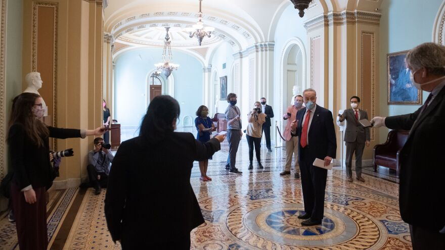 Senate Minority Leader Chuck Schumer speaks to the press as the Senate returned to session Monday at the U.S. Capitol.