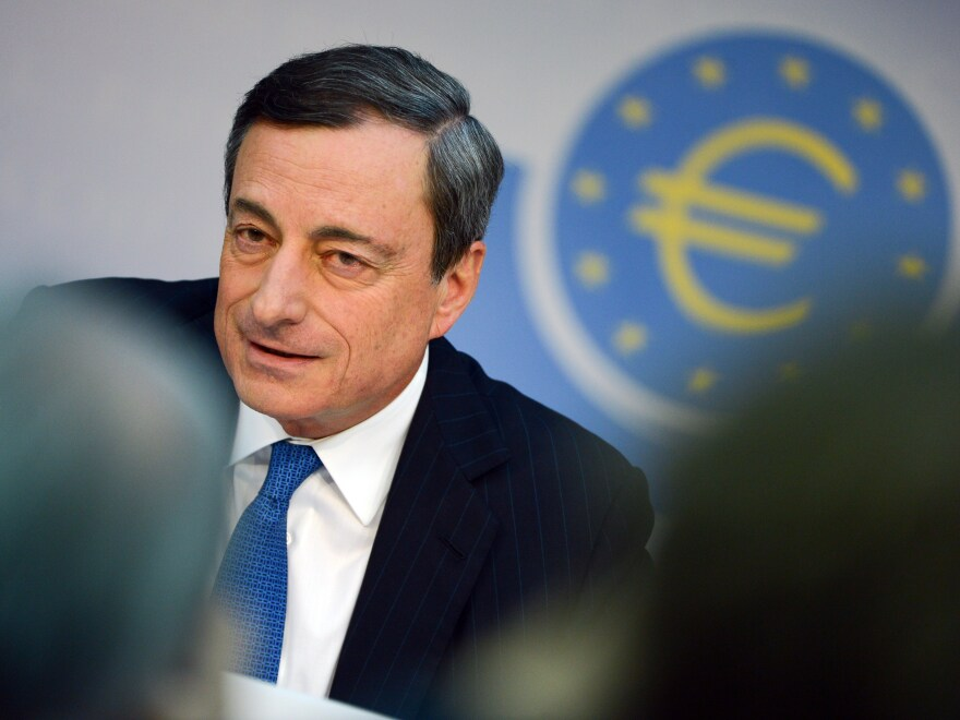 European Central Bank President Mario Draghi speaks at a news conference Thursday in Frankfurt after the ECB said it was cutting rates.