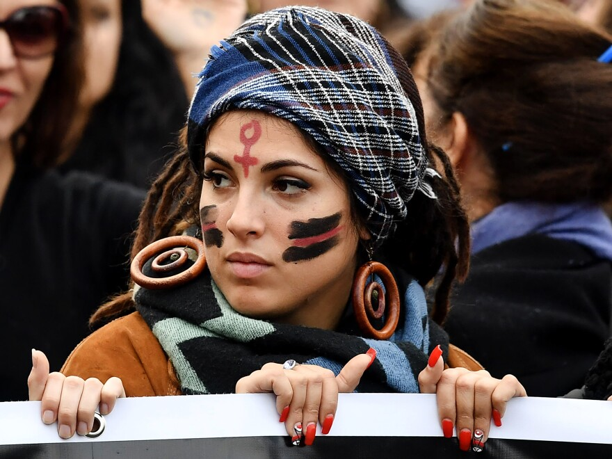 A woman takes part in a demonstration to mark the International Day for the Elimination of Violence Against Women in Rome in November 2017.