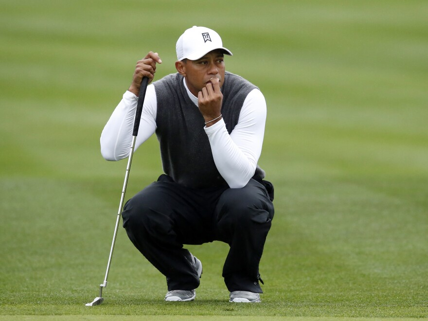 Tiger Woods on the ninth hole during the second round of the Phoenix Open last Friday, in Scottsdale, Ariz. Woods, who'll turn 40 this year, is making Frank Deford wonder: How does an athlete know when to retire?