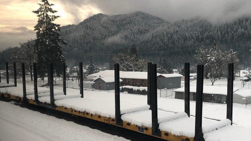 An Amtrak train carrying 183 passengers finally chugged along Tuesday after a day-and-half standstill in rural Oregon amid heavy snow.