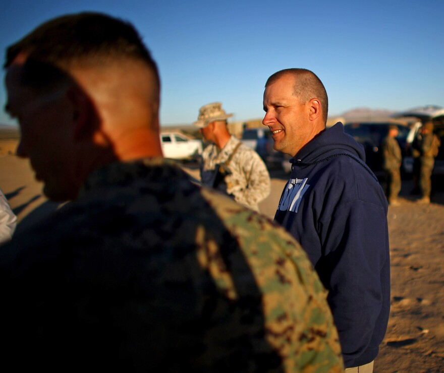 Paul Johnson is a civilian who is monitoring the Marine exercise and collecting data to help the Marines answer the question of whether to open combat jobs to female Marines.