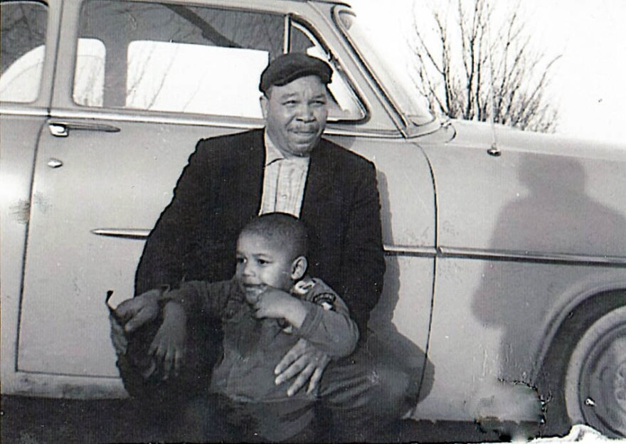 Percy White Jr. holds his son Percy White III, circa 1963.