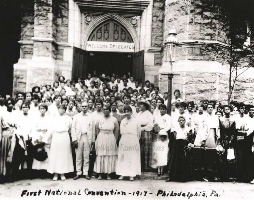 In 1917, Madam C.J. Walker hosted the first national convention of what she called her beauty culturists at Philadelphia's Union Baptist Church. Walker is in the middle of the front row wearing an aproned dress.