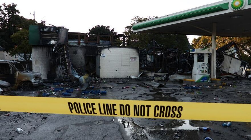 A damaged gas station after protesters set fire to several vehicles and businesses in Milwaukee.