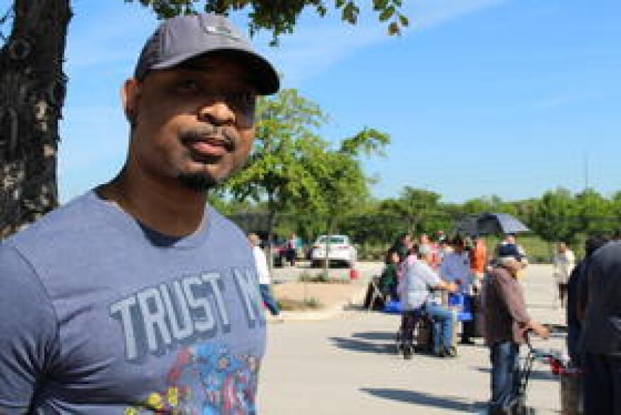 45 year-old Gulf War veteran Daren Benito waits his turn at the Austin VA's mobile food pantry. A single father, he has gone without adequate food in order to provide for his children.