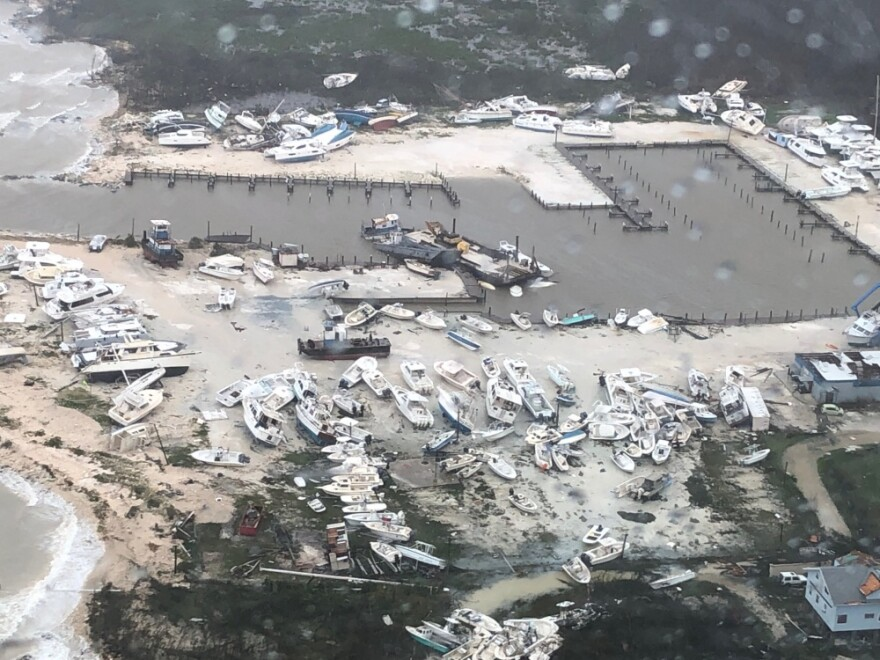 Coast Guard Air Station Clearwater forward-deployed four MH-60 Jayhawk helicopter crews in support of search and rescue and humanitarian aid in the Bahamas, Sept. 2, 2019. (U.S. Coast Guard photo courtesy of Coast Guard Air Station Clearwater)