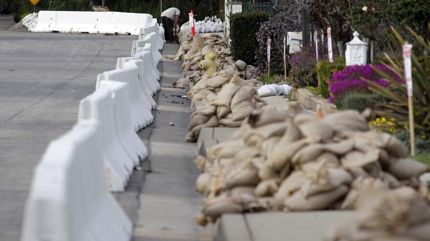Before the deluge: Sandbags and barriers lined a road in Glendora, Calif., on Thursday. Authorities expect flooding as heavy rains spread across the area.