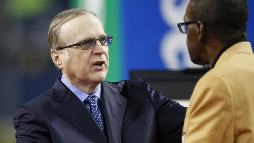 Paul Allen greets NFL Hall of Famer and former Seahawk Kenny Easley as his number is retired at CenturyLink Field last year.