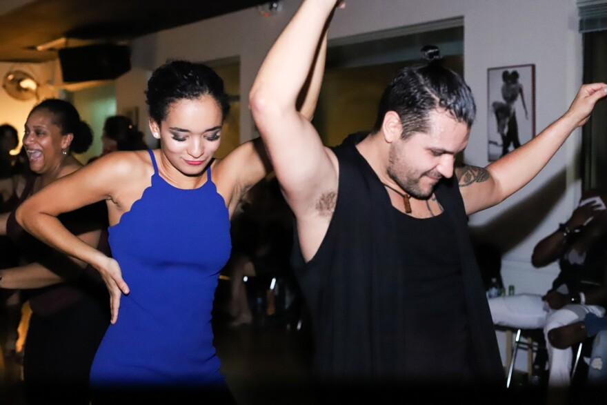 Juliana Paiva (left) and Hugo Trejo (right) dance at Convergence Dance and Body Center. October 19, 2019