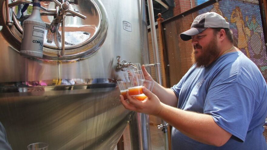 Evan Fritz, head brewer at Manayunk Brewing Co., draws off some samples of Papal Pleasure, a beer concocted to mark Pope Francis' visit to Philadelphia. It's brewed with water blessed by a local priest.