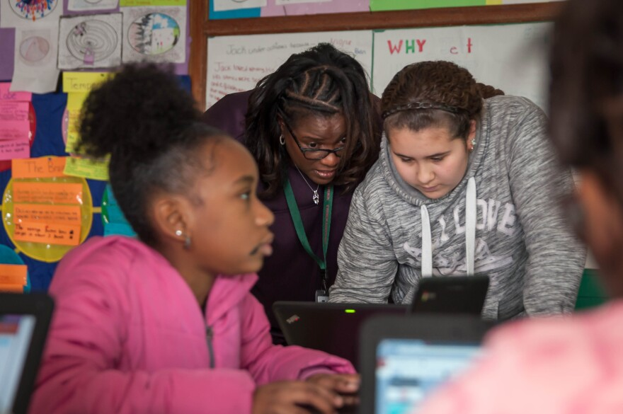 Sonja Brewer, center, works with a gifted learning student March 7, 2018, at Washington Elementary School in Normandy. The gifted program was restored this school year.