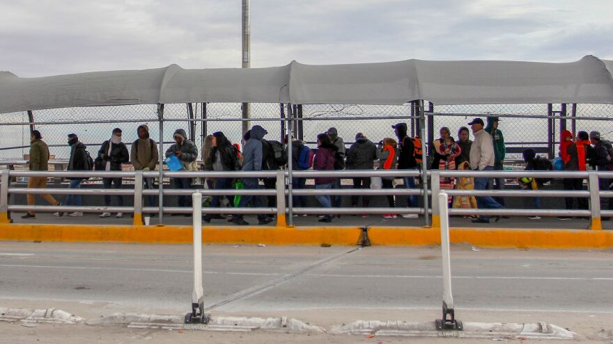 Migrants line up at the Paso del Norte International Bridge in Ciudad Juarez, Mexico, waiting to cross the border and request asylum in January. Thousands of asylum-seekers are waiting in Mexican border cities like Juarez right now, hoping for their turn to legally cross the border and make their case in court.