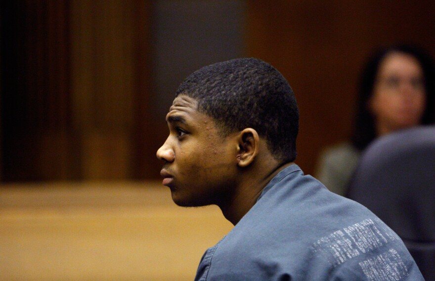 Davontae Sanford, sitting in a Detroit courtroom in 2010, was charged with assault during an incident in a youth detention facility.