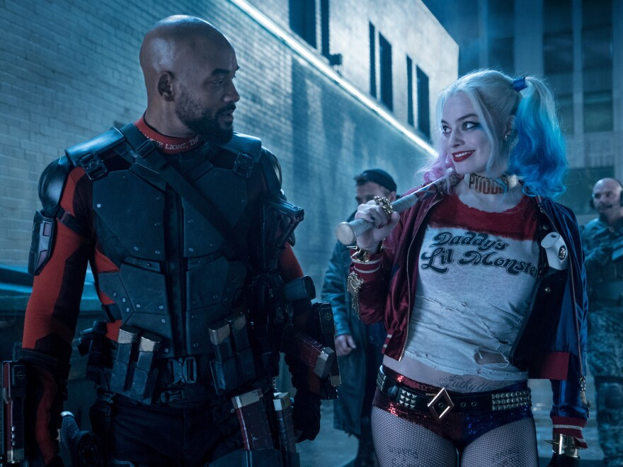 Will Smith stars as Deadshot, alongside Margot Robbie's Harley Quinn in the upcoming <em>Suicide Squad</em> movie.