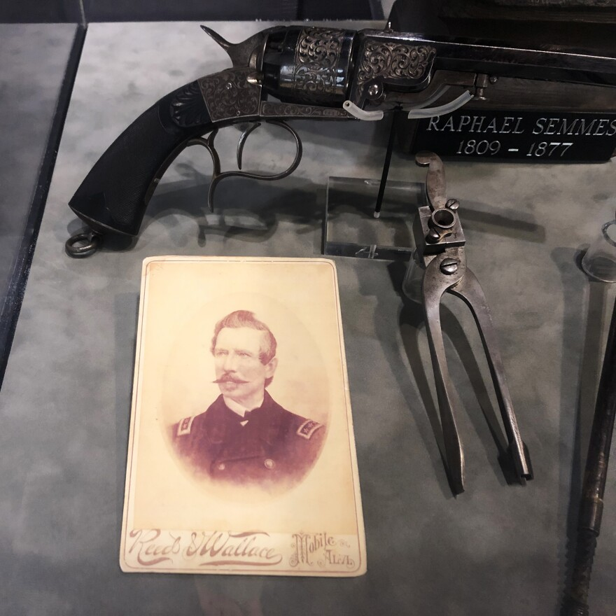 A photograph of Adm. Raphael Semmes on display with other artifacts at the History Museum of Mobile. A bronze statue of Semmes removed from prominent display in downtown Mobile has been moved to the museum where Mayor Sandy Stimpson says it can be interpreted with historical context.