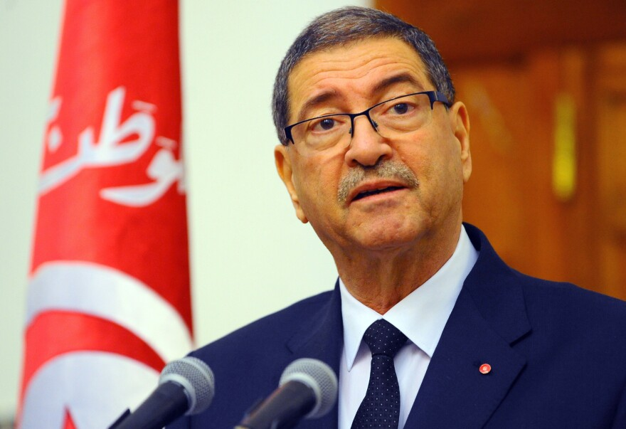 Tunisian Prime Minister Habid Essid addresses the media in the capital, Tunis, on March 8. He spoke a day after clashes between government forces and extremists in southern Tunisia, near the Libyan border, which left more than 50 dead.