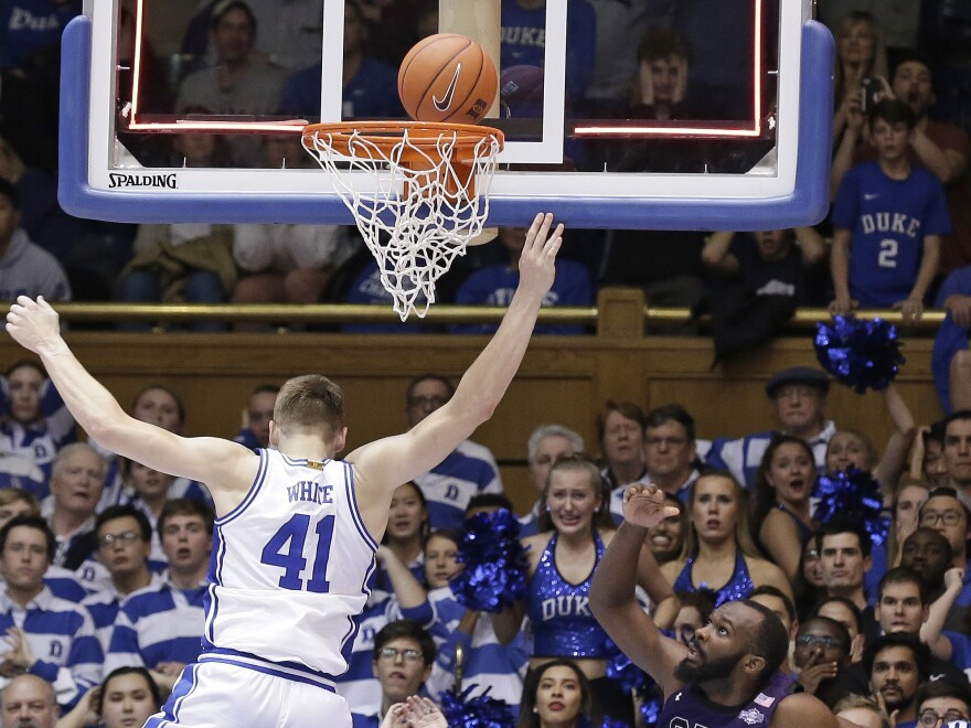 Stephen F. Austin's Bain watches the game-winning basket as Duke forward Jack White attempts to defend.