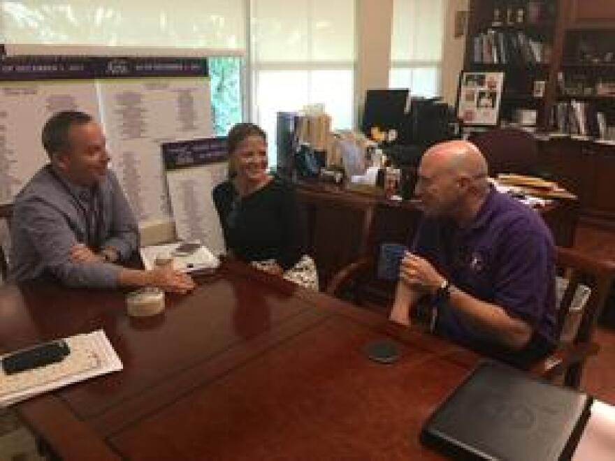 From left, teachers Glen Turf and Marisol Sardina, and outgoing head of school John Davies, during a recent interview in Davies' office at Miami Country Day School.