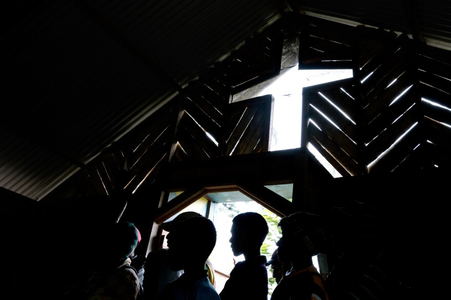 People crowd into a church in the town of Henganofi in the Eastern Highlands of Papua New Guinea for a meeting to end violence resulting from sorcery accusations. In the Eastern Highlands, the accusation of sorcery is a vigilante's rallying cry. Nationally, it's believed to be responsible for dozens of deaths every year.